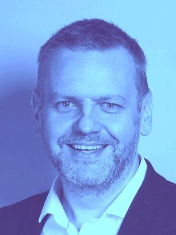Graham Millar Head shot BLUE 3 L website