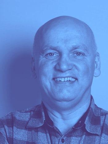 Julian Scott Head shot L BLUE website2