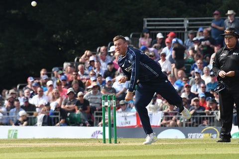 Mark Watt bowling by Alec Davies