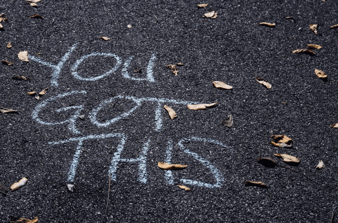 the words, you got this, written in chalk on the ground