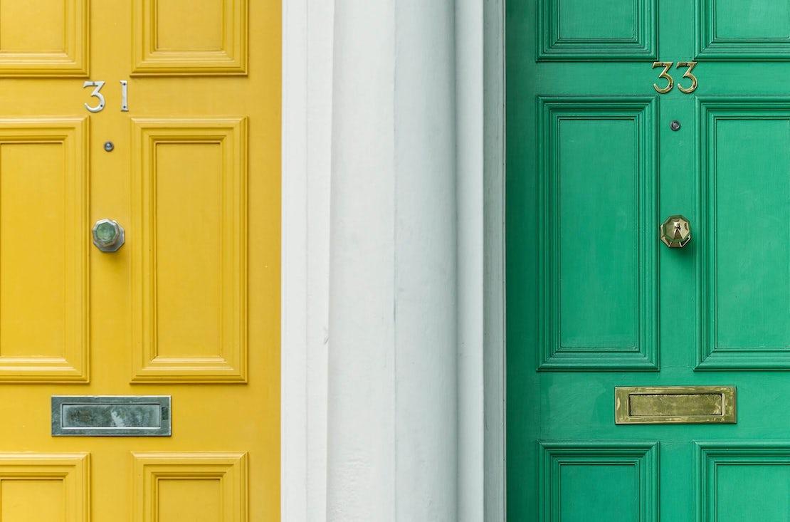 a yellow door and a green door