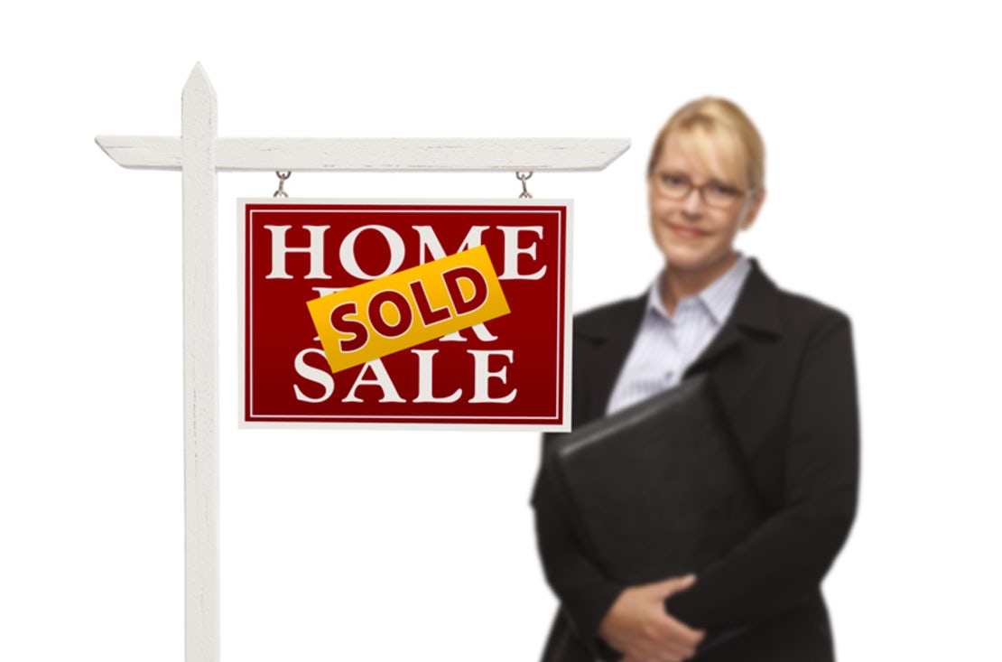 sold sign with estate agent